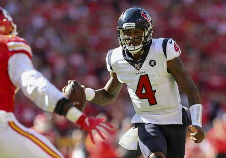 Houston Texans quarterback Deshaun Watson (4) scrambles out of the pocket on his way to the game-winning one-yard rushing touchdown against the Kansas City Chiefs during the fourth quarter of an NFL game at Arrowhead Stadium Sunday, Oct. 13, 2019, in Kansas City, Mo. The Texans won 31-24.