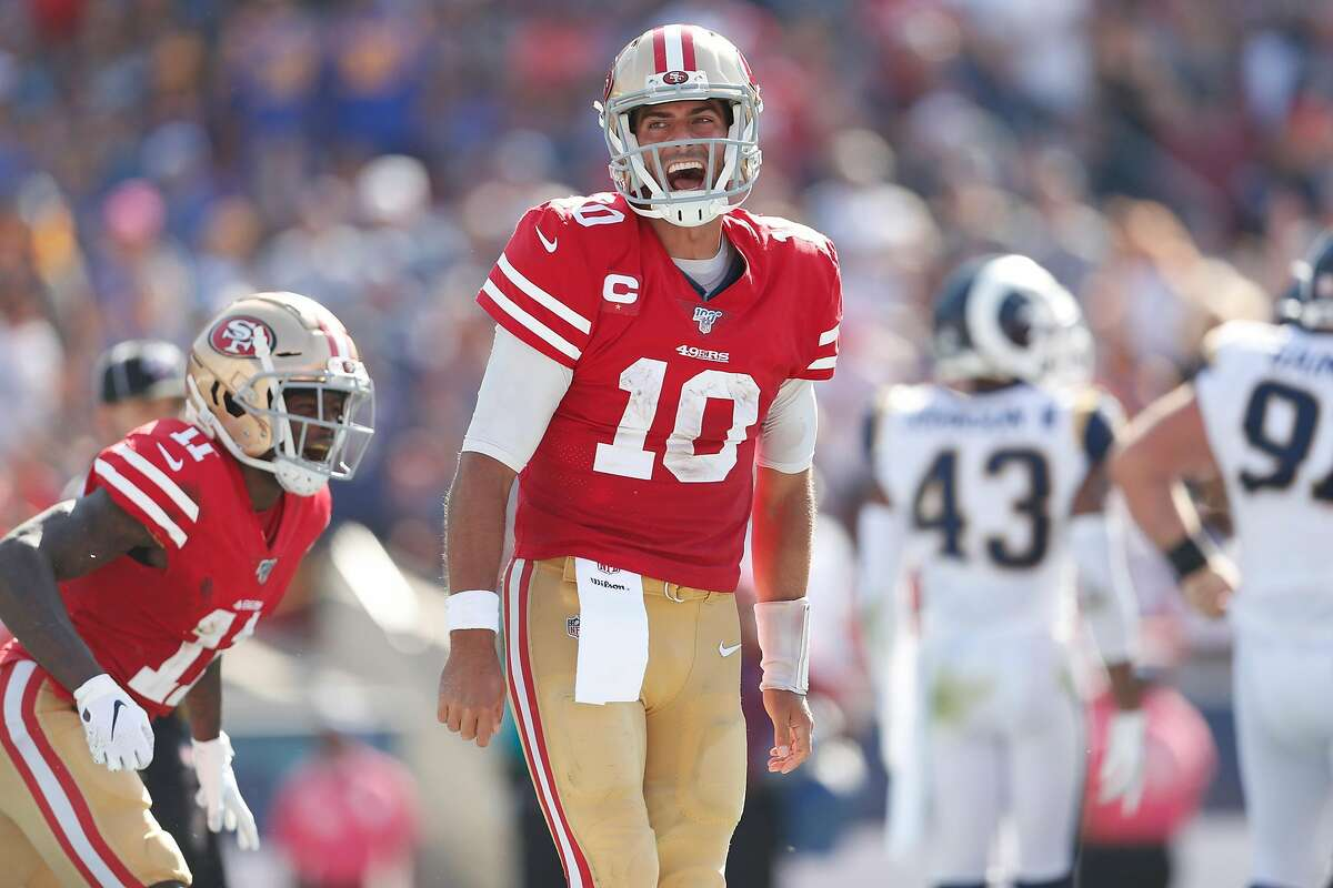 San Francisco 49ers' Jimmy Garoppolo celebrates his 3rd quarter touchdown against Los Angeles Rams' during NFL game at Los Angeles Coliseum in Los Angeles, Calif., on Sunday, October 13, 2019.