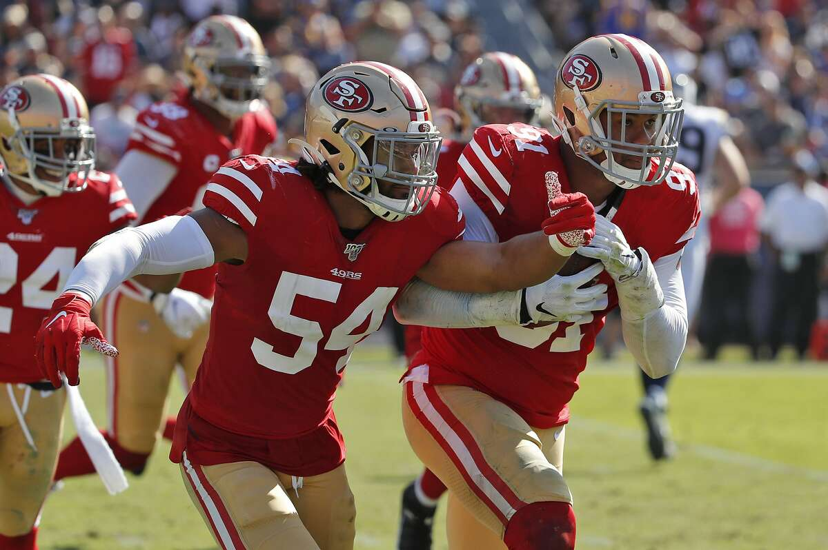 San Francisco 49ers defensive end Arik Armstead, right, recovers a fumble against the Los Angeles Rams during the first half of an NFL football game Sunday, Oct. 13, 2019, in Los Angeles. (AP Photo/John Locher)