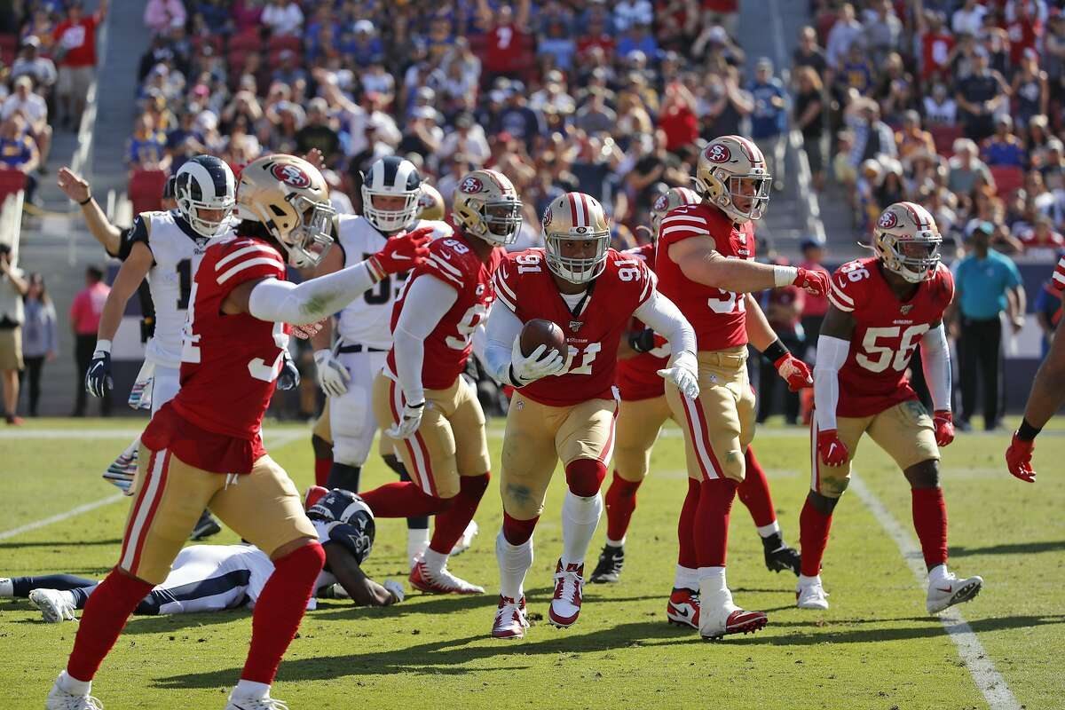 San Francisco 49ers defensive end Arik Armstead (91) recovers a fumble against the Los Angeles Rams during the first half of an NFL football game Sunday, Oct. 13, 2019, in Los Angeles. (AP Photo/John Locher)