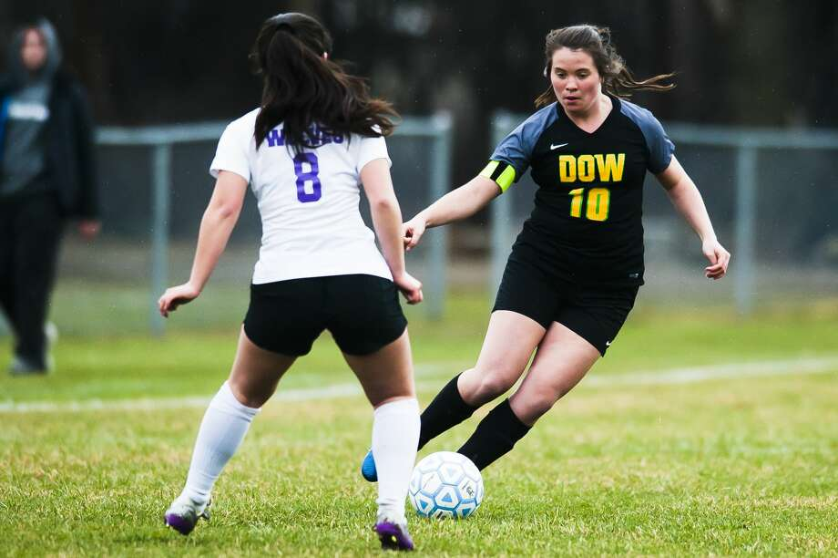 Dow High's Elizabeth Green tries to maneuver around a Traverse City Central defender during an April 17, 2019 match. Photo: Daily News File Photo