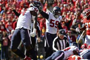 Houston Texans defensive end Charles Omenihu (94) celebrates after causing Kansas City Chiefs quarterback Patrick Mahomes to fumble the ball for a turnover, during the first half of an NFL football game in Kansas City, Mo., Sunday, Oct. 13, 2019. (AP Photo/Ed Zurga)