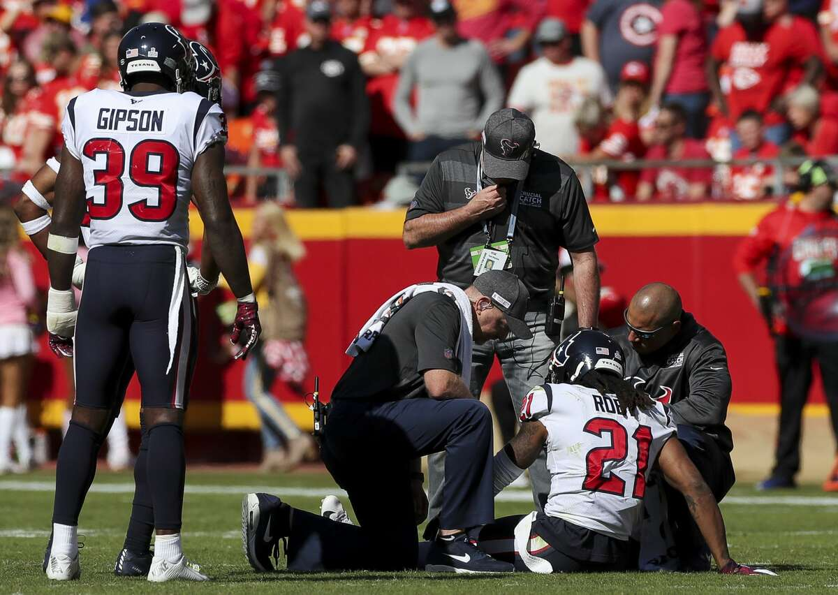 Houston Texans cornerback Bradley Roby (21) receives medial treatment on the field during the third quarter of an NFL game against the Kansas City Chiefs at Arrowhead Stadium Sunday, Oct. 13, 2019, in Kansas City, Mo. Roby left the game. The Texans won 31-24.