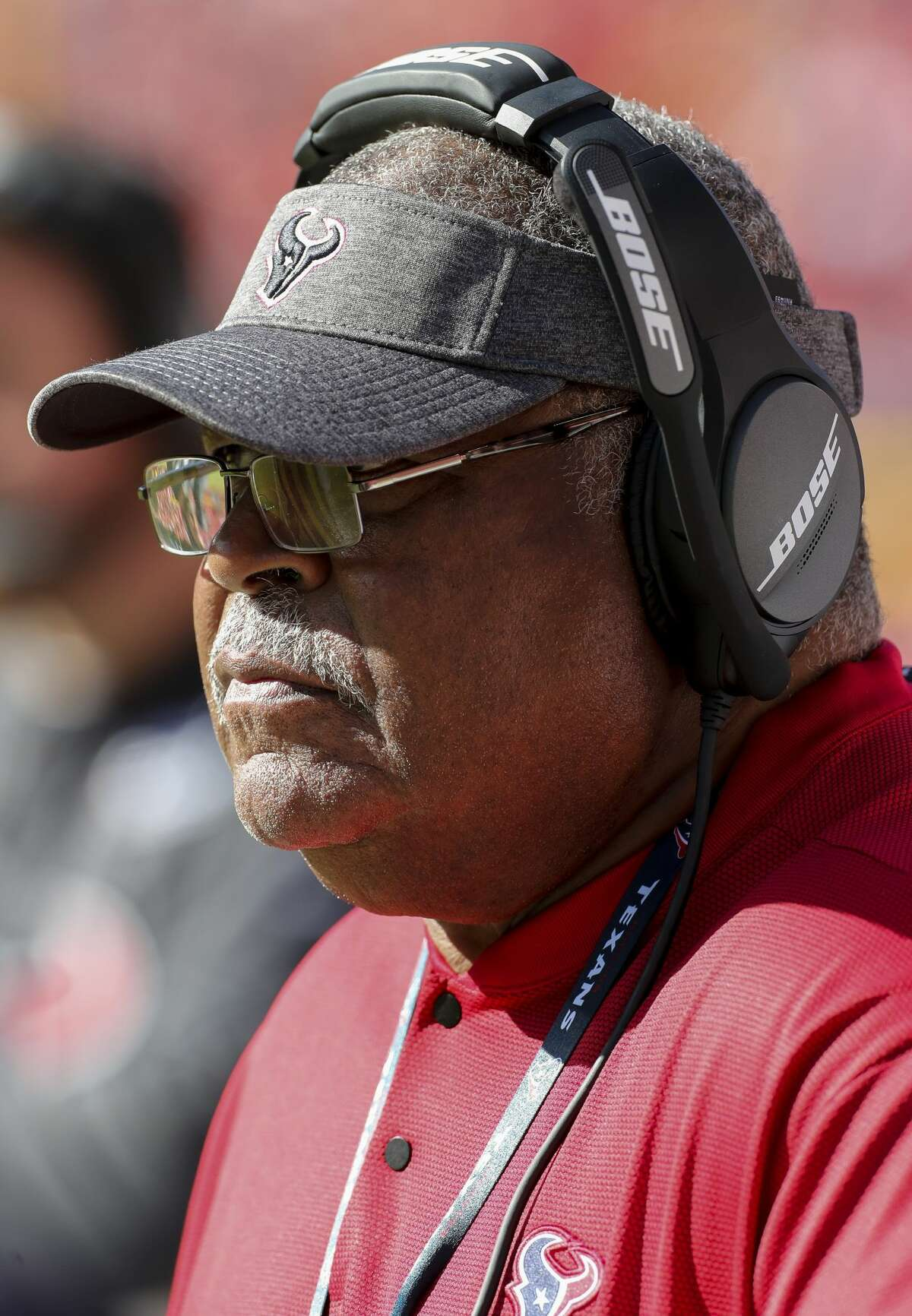 Houston Texans defensive coordinator Romeo Crennel looks to the field from the sidelines during the fourth quarter of an NFL game against the Kansas City Chiefs at Arrowhead Stadium Sunday, Oct. 13, 2019, in Kansas City, Mo. The Texans won 31-24.