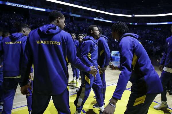 Golden State Warriors guard Stephen Curry, center, is introduced before a preseason NBA basketball game against the Los Angeles Lakers in San Francisco, Saturday, Oct. 5, 2019. (AP Photo/Jeff Chiu)