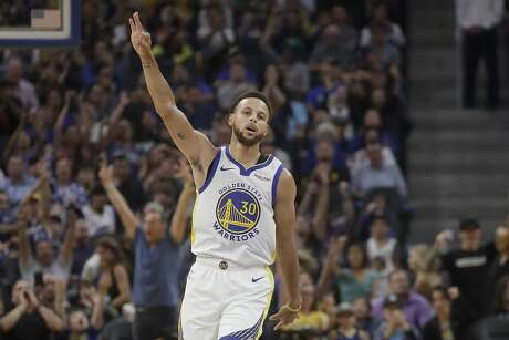 Golden State Warriors guard Stephen Curry gestures after making a 3-point basket against the Los Angeles Lakers during the first half of a preseason NBA basketball game in San Francisco, Saturday, Oct. 5, 2019. (AP Photo/Jeff Chiu)
