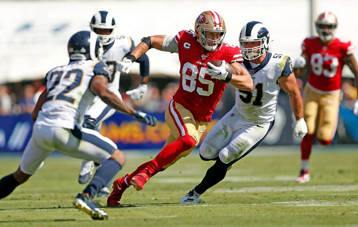 San Francisco 49ers' George Kittle runs after a catch in 2nd quarter against Los Angeles Rams during NFL game at Los Angeles Coliseum in Los Angeles, Calif., on Sunday, October 13, 2019.