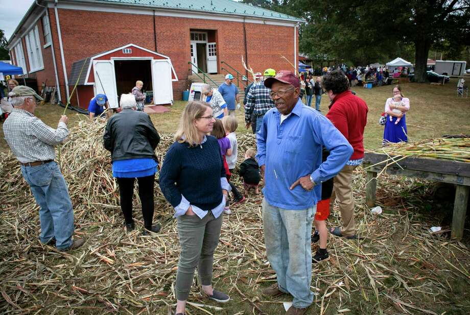 Virginia House candidate Christian Worth, left, talks with Jasper Fletcher while meeting with potential voters Saturday, Oct. 5, 2019, at the Sorghum Festival in Clifford, Virginia. Worth is a Democrat. Photo: Photo For The Washington Post By Julia Rendleman. / Julia Rendleman