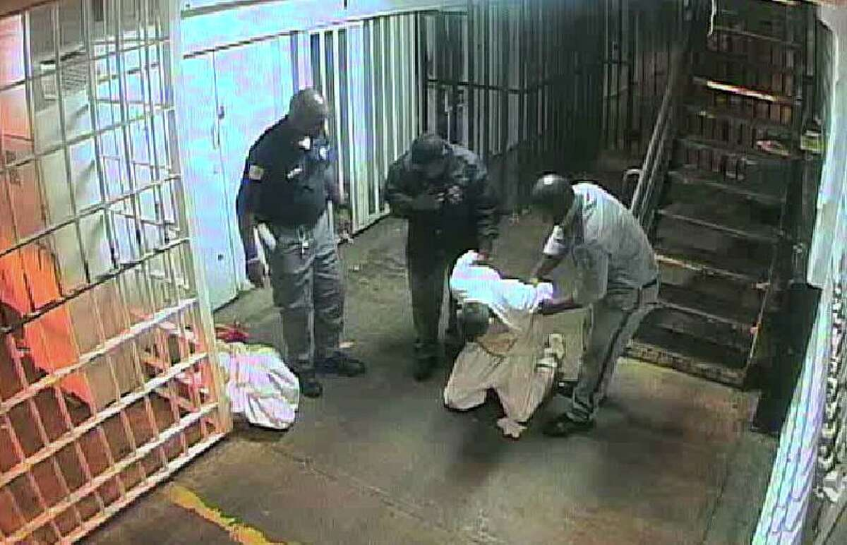 After he was slammed to the ground by a prison sergeant, inmate David Witt struggled to stand up.