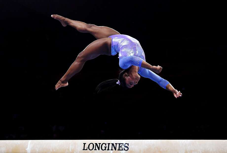 Simone Biles competes on the balance beam at the world championships in Stuttgart, Germany. She won gold in the event. Photo: Laurence Griffiths / Getty Images