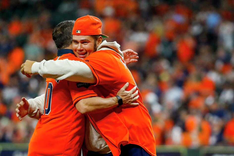 Former Astros pitcher Mike Hampton hugs Jose Lima, Jr., after Hampton threw out the ceremonial first pitch before Game 2 of the American League Championship Series at Minute Maid Park on Sunday, Oct. 13, 2019, in Houston.
