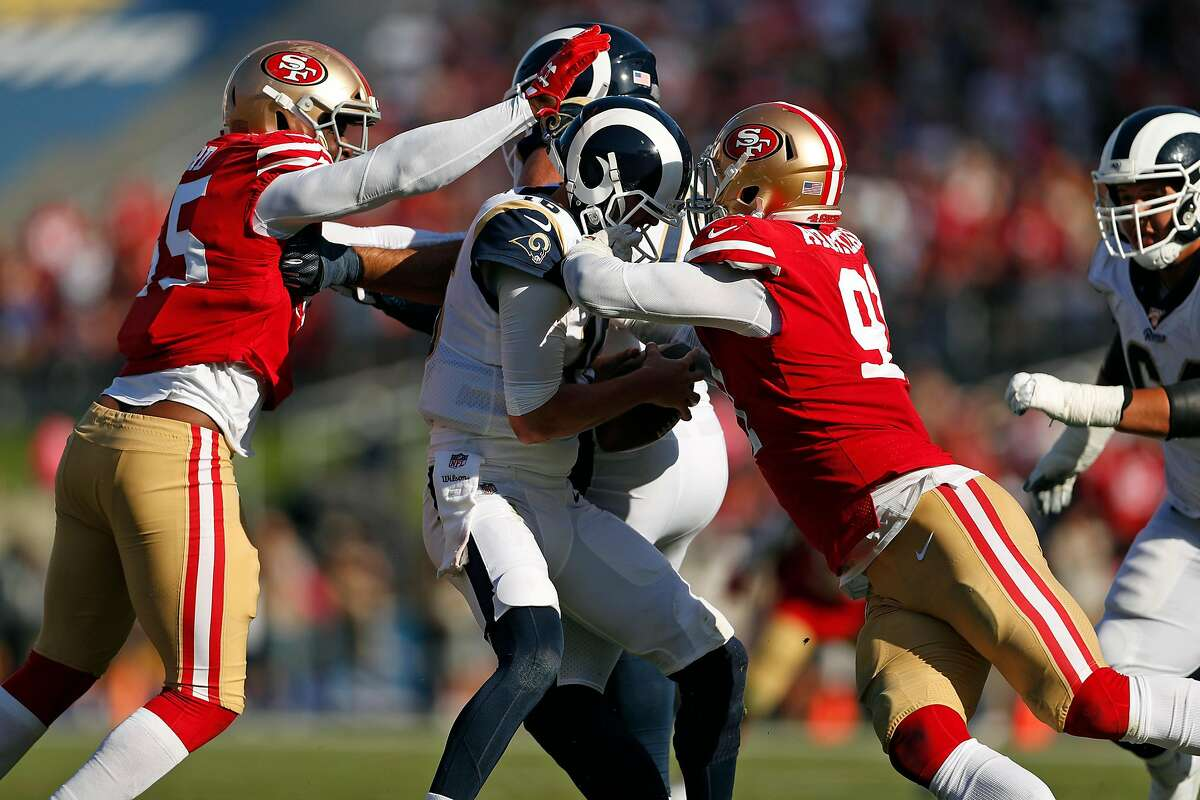 San Francisco 49ers' Dee Ford and Arik Armstead sack Los Angeles Rams' Jared Goff in 4th quarter of Niners' 20-7 win during NFL game at Los Angeles Coliseum in Los Angeles, Calif., on Sunday, October 13, 2019.