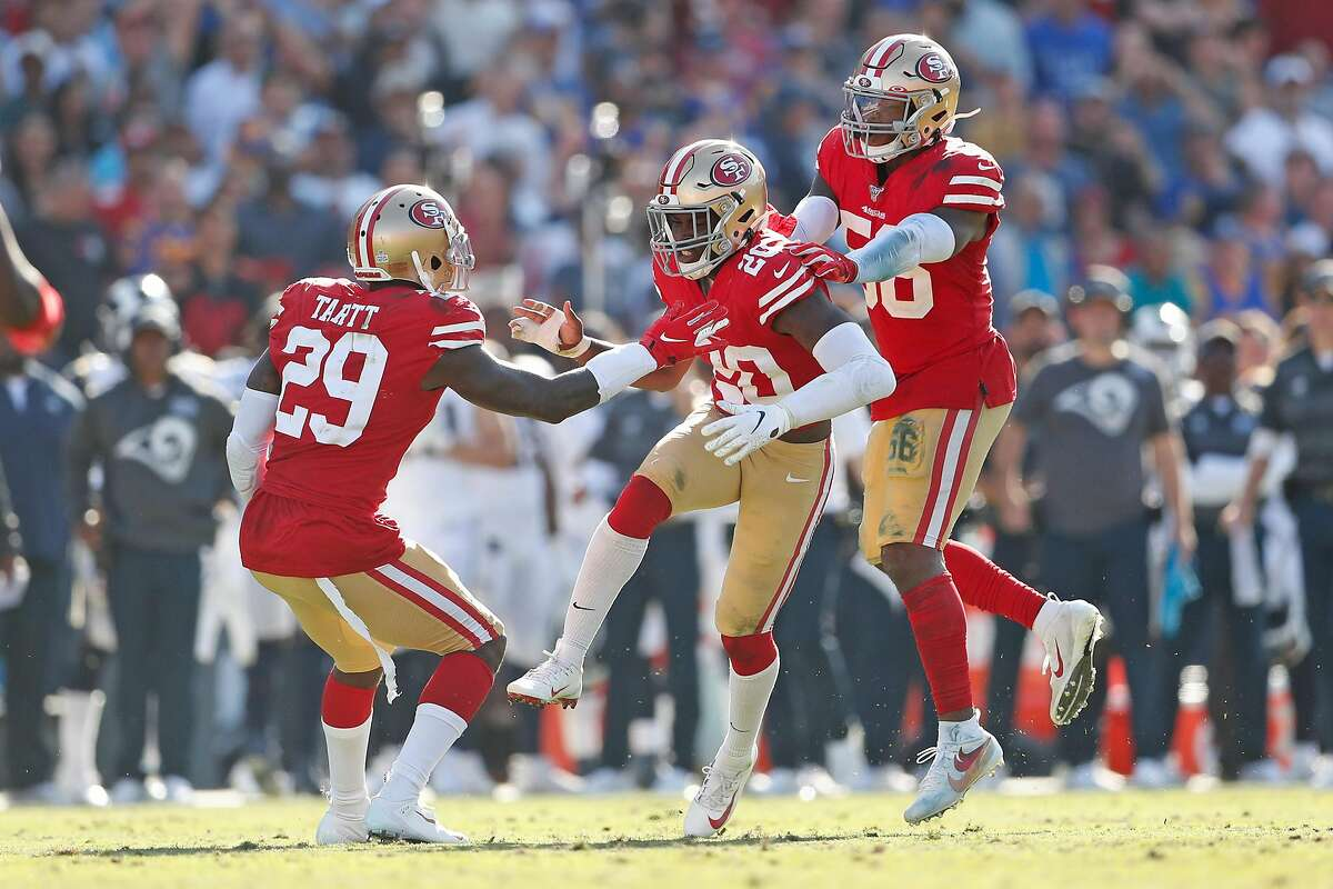 San Francisco 49ers' Jimmie Ward celebrates with Jaquiski Tartt and Kwon Alexander after a defensive stop in 4th quarter of Niners' 20-7 win during NFL game at Los Angeles Coliseum in Los Angeles, Calif., on Sunday, October 13, 2019.