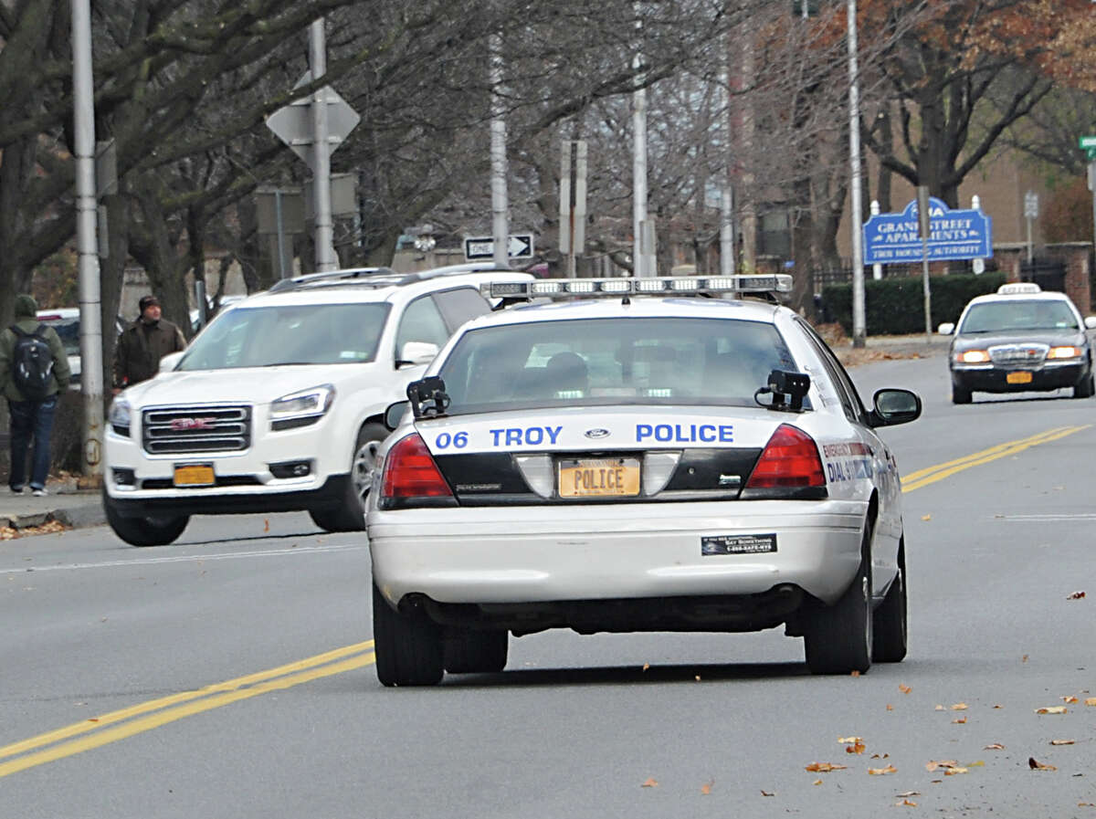 A police car leaves the Troy Police Department on 6th Ave. Friday, Nov. 21, 2014 in Troy, N.Y. Mayor Lou Rosamilia is expected to recommend several changes to his budget which may include changes to the police and fire departments. (Lori Van Buren / Times Union)