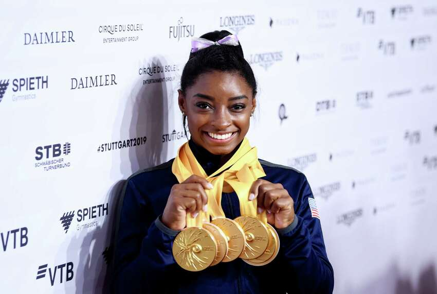 STUTTGART, GERMANY - OCTOBER 13: Simone Biles of The United States poses for photos with her multiple gold medals during day 10 of the 49th FIG Artistic Gymnastics World Championships at Hanns-Martin-Schleyer-Halle on October 13, 2019 in Stuttgart, Germany. (Photo by Laurence Griffiths/Getty Images) *** BESTPIX ***