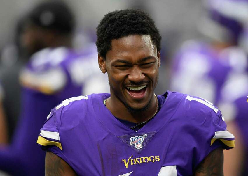 MINNEAPOLIS, MINNESOTA - OCTOBER 13: Stefon Diggs #14 of the Minnesota Vikings looks on from the bench during the fourth quarter of the game against the Philadelphia Eagles at U.S. Bank Stadium on October 13, 2019 in Minneapolis, Minnesota. The Vikings defeated the Eagles 38-20. (Photo by Hannah Foslien/Getty Images)