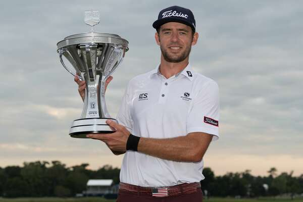 Lanto Griffin poses with the Houston Open trophy at the Golf Club of Houston in Humble Texas on Sunday, October 13, 2019.