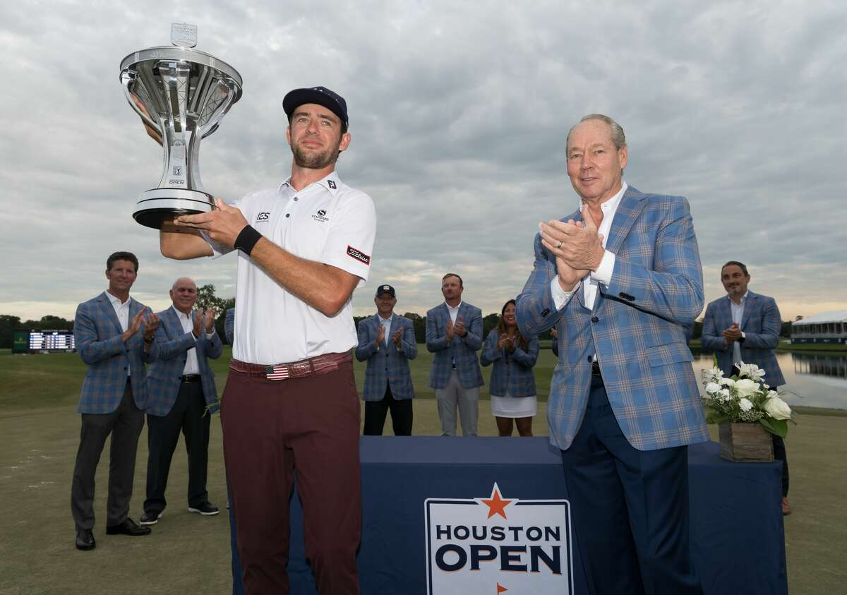 Lanto Griffin standing next to Jim Crane, holds up the trophy after winning the Houston Open at the Golf Club of Houston in Humble Texas on Sunday, October 13, 2019.