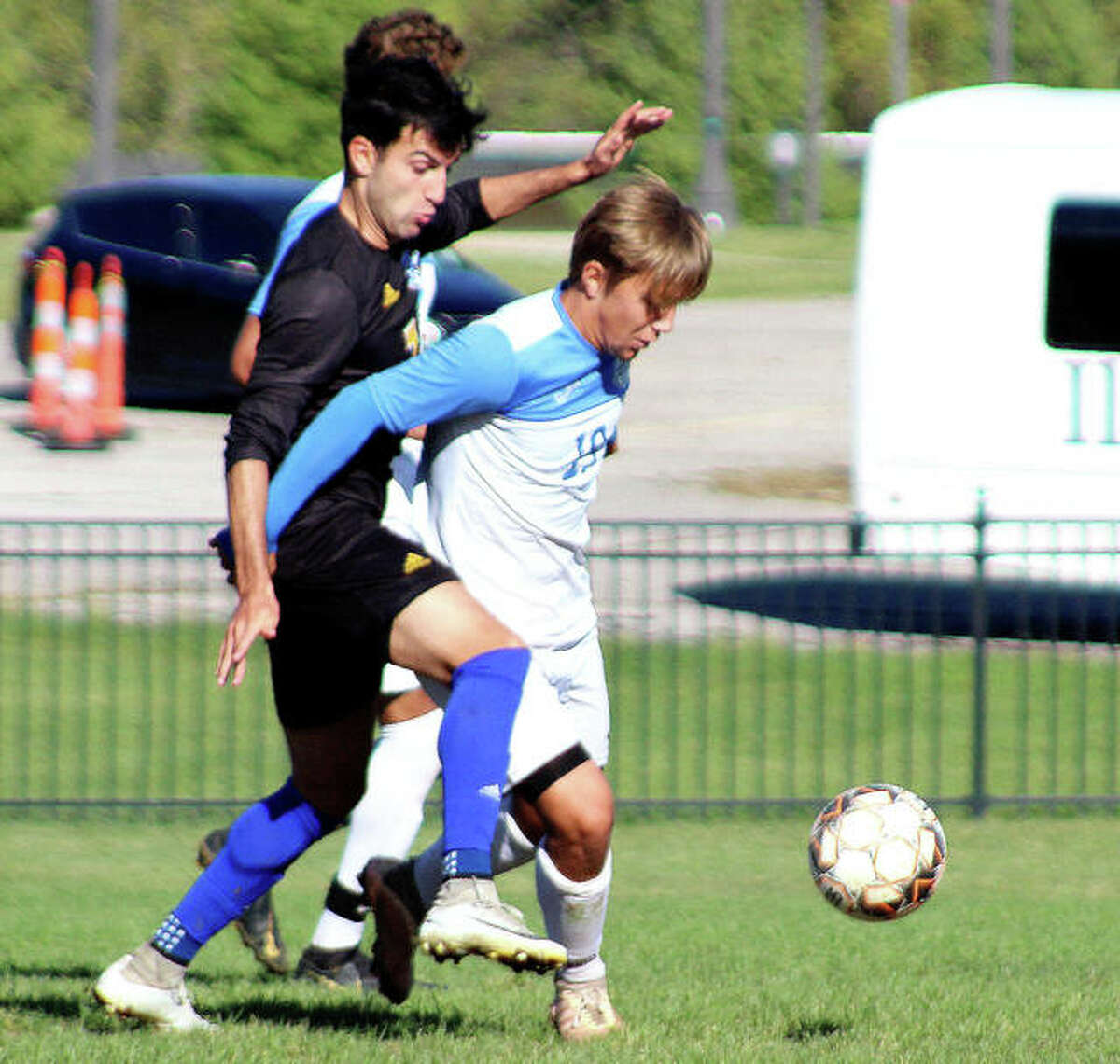 Victor Strandahl of Lewis and Clark, right, shields the ball from Nathan Monne of Illinois Central College during Sunday's Region 24 game at Tim Rooney Stadium.