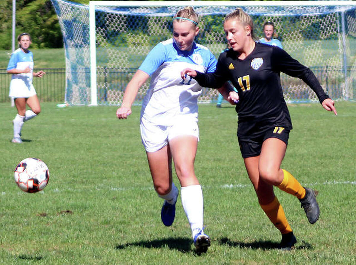 Candice Parziani of LCCC (11) battles chases after the ball along with Illinois Central's McKenzie Cupi Sunday at LCCC.