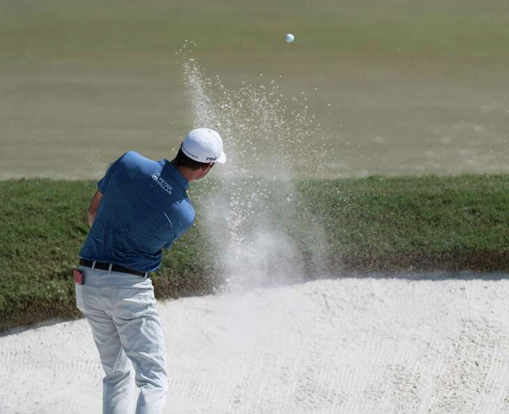 Harris English hitting out of a sand trap on the 8th green during the Houston Open at the Golf Club of Houston in Humble Texas on Sunday, Oct. 13, 2019.