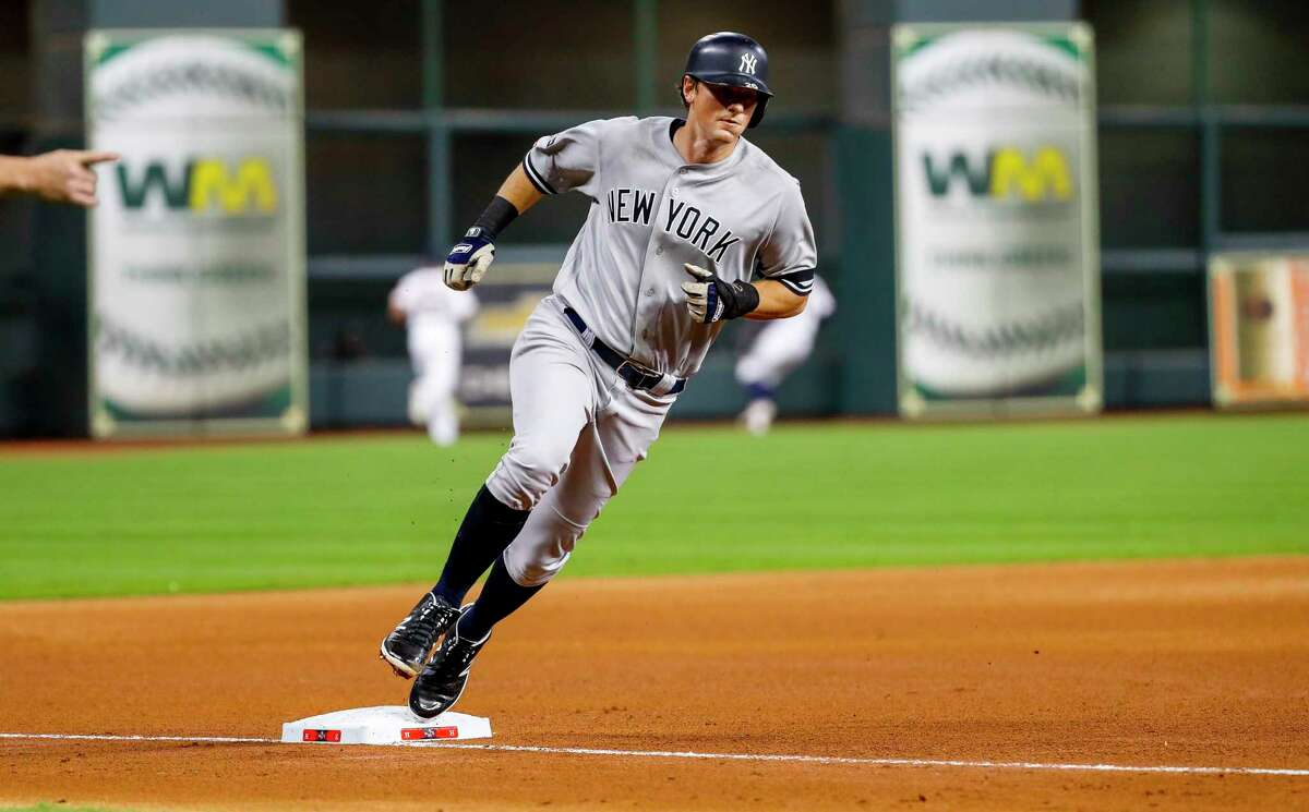 New York Yankees first baseman DJ LeMahieu (26) rounds third going to home after a double by New York Yankees second baseman Gleyber Torres (25) during the fourth inning of Game 1 of the American League Championship Series at Minute Maid Park on Saturday, Oct. 12, 2019, in Houston.
