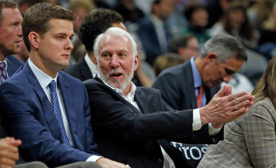 Gregg Popovich head coach of the San Antonio Spurs talks with Will Hardy assistant coach of the San Antonio Spurs during game against theNew Orleans Pelicans on Sunday, October 13, 2019. Photo: Ronald Cortes/Contributor / 2019 Ronald Cortes