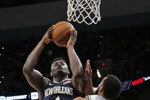Zion Williamson #1  of the New Orleans Pelicans shoots over Trey Lyles #41 of the San Antonio Spurs on Sunday, October 13, 2019.