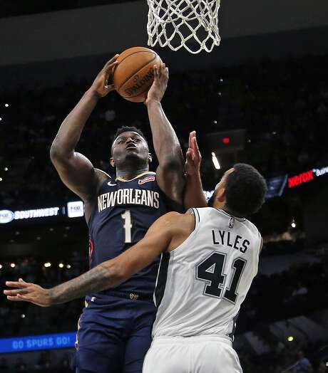 Zion Williamson #1  of the New Orleans Pelicans shoots over Trey Lyles #41 of the San Antonio Spurs on Sunday, October 13, 2019. Photo: Ronald Cortes/Contributor