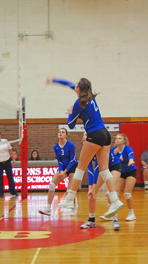 Onekama's Colleen McCarthy records a kill at the Suttons Bay Invitational on Saturday. (Courtesy photo) Photo: Courtesy Photo