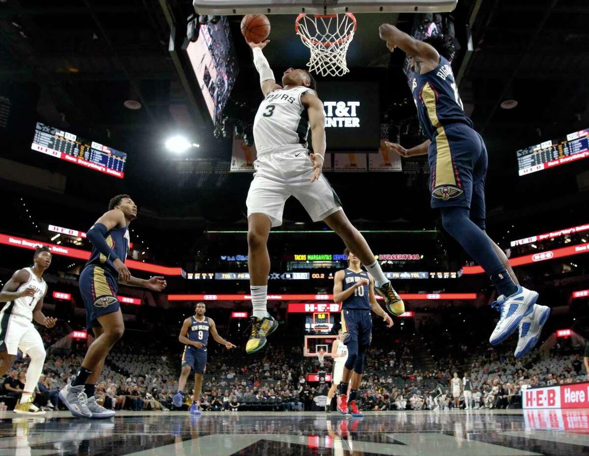 Keldon Johnson of the San Antonio Spurs scores against the New Orleans Pelicans on Sunday, October 13, 2019.
