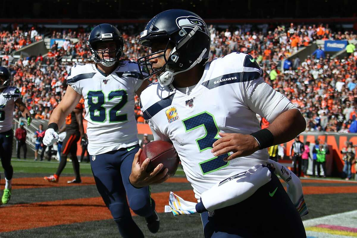 CLEVELAND, OHIO - OCTOBER 13: Russell Wilson #3 of the Seattle Seahawks scores a first quarter touchdown against the Cleveland Browns at FirstEnergy Stadium on October 13, 2019 in Cleveland, Ohio. (Photo by Gregory Shamus/Getty Images)