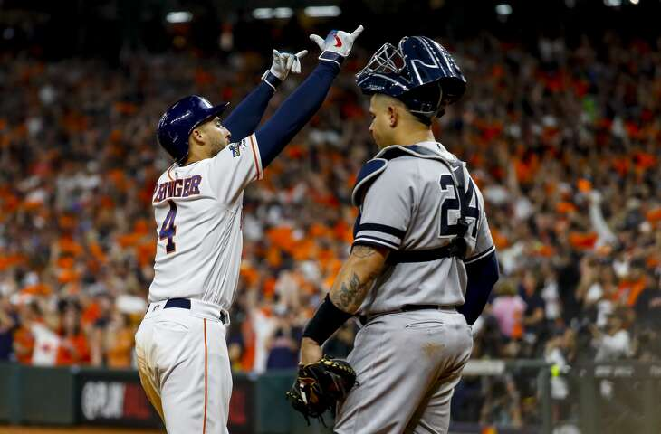 Houston Astros center fielder George Springer (4) crosses home plate after hitting a solo home run to tie the game 2-2 during the fifth inning of Game 2 of the American League Championship Series at Minute Maid Park on Sunday, Oct. 13, 2019, in Houston.