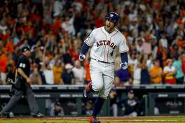 Houston Astros center fielder George Springer (4) yells back at the dugout as he runs the bases after hitting a solo home run to tie the game 2-2 during the fifth inning of Game 2 of the American League Championship Series at Minute Maid Park on Sunday, Oct. 13, 2019, in Houston.