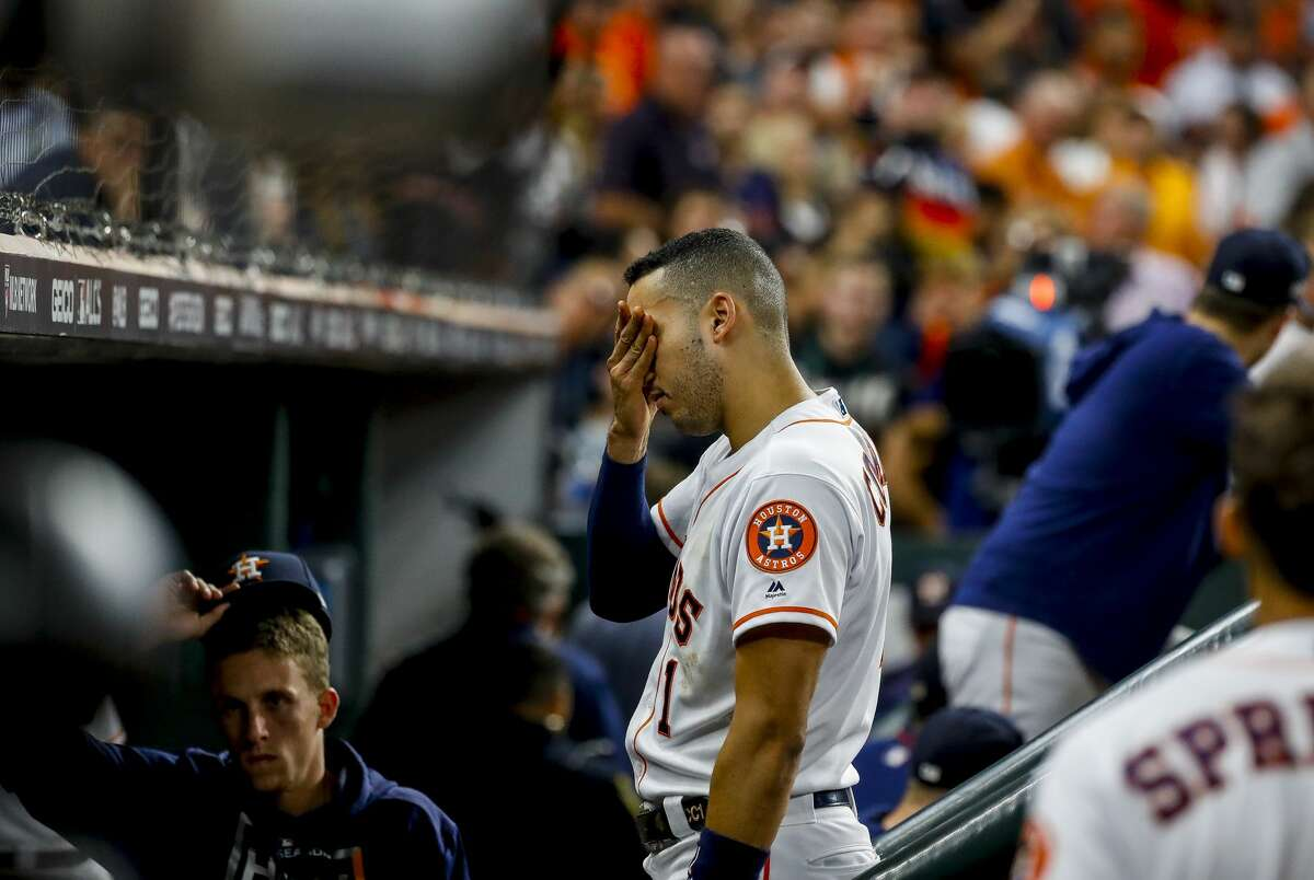 Houston Astros shortstop Carlos Correa (1) reacts as a staff member is attended to after being struck by a foul ball from the bat of Houston Astros left fielder Michael Brantley (23) during the fifth inning of Game 2 of the American League Championship Series at Minute Maid Park on Sunday, Oct. 13, 2019, in Houston.