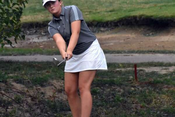 EHS senior Jessica Benson hits a chip shot onto the 11th green during the Class 2A Mascoutah Regional in Belleville.