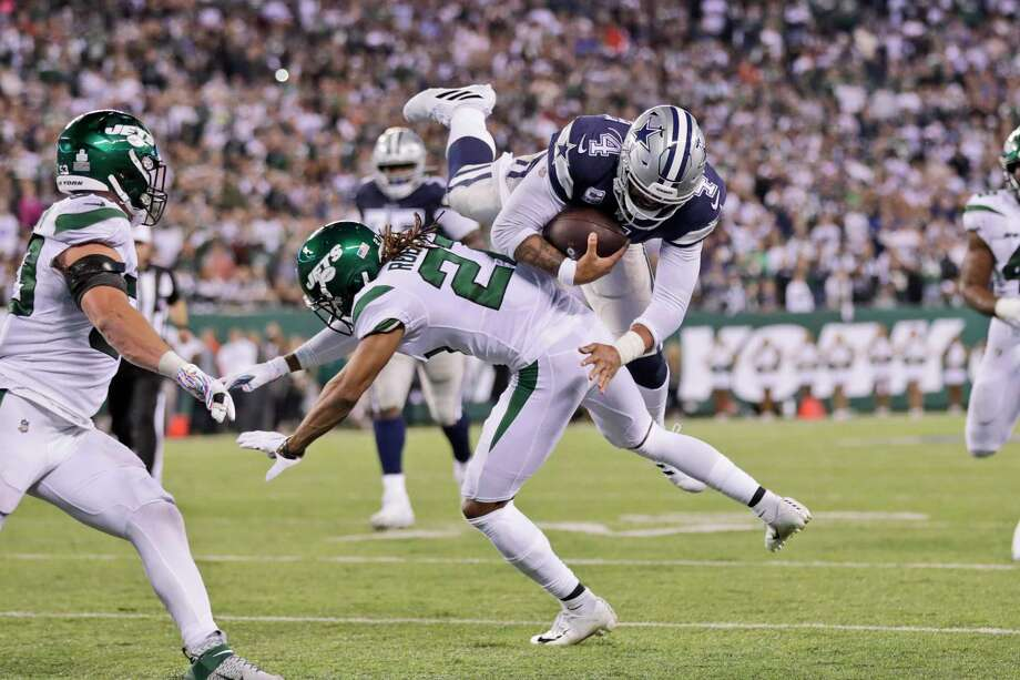 Jets cornerback Darryl Roberts takes down scrambling Cowboys quarterback Dak Prescott during the second half Sunday at MetLife Stadium. Photo: Adam Hunger /Associated Press / Copyright 2019 The Associated Press. All rights reserved.