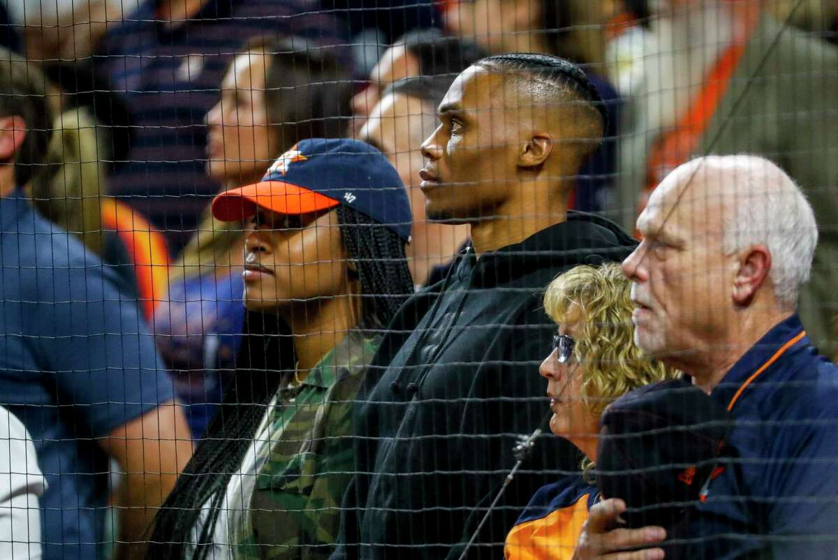 Houston Rockets guard Russell Westbrook listens to God Bless America during the seventh inning of Game 2 of the American League Championship Series at Minute Maid Park on Sunday, Oct. 13, 2019, in Houston.