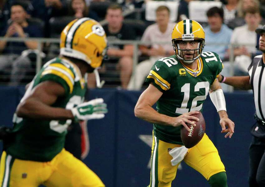 Green Bay Packers quarterback Aaron Rodgers (12) looks to throw a pass in the first half of an NFL football game against the Dallas Cowboys in Arlington, Texas, Sunday, Oct. 6, 2019. (AP Photo/Michael Ainsworth)