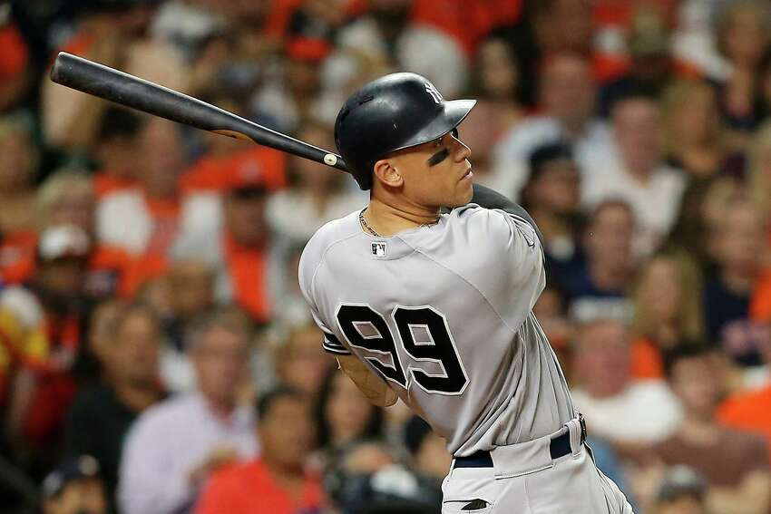 HOUSTON, TEXAS - OCTOBER 13: Aaron Judge #99 of the New York Yankees hits a two-run home run during the fourth inning against the Houston Astros in game two of the American League Championship Series at Minute Maid Park on October 13, 2019 in Houston, Texas. (Photo by Bob Levey/Getty Images)