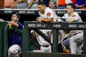 Houston Astros starting pitcher Justin Verlander (35), second baseman Jose Altuve (27) and third baseman Alex Bregman (2) watch from the dugout during the ninth inning of Game 2 of the American League Championship Series at Minute Maid Park on Sunday, Oct. 13, 2019, in Houston.