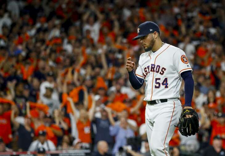 Houston Astros relief pitcher Roberto Osuna (54) strikes out New York Yankees designated hitter Edwin Encarnacion (30) to end the top of the eighth inning during Game 2 of the American League Championship Series at Minute Maid Park on Sunday, Oct. 13, 2019, in Houston.