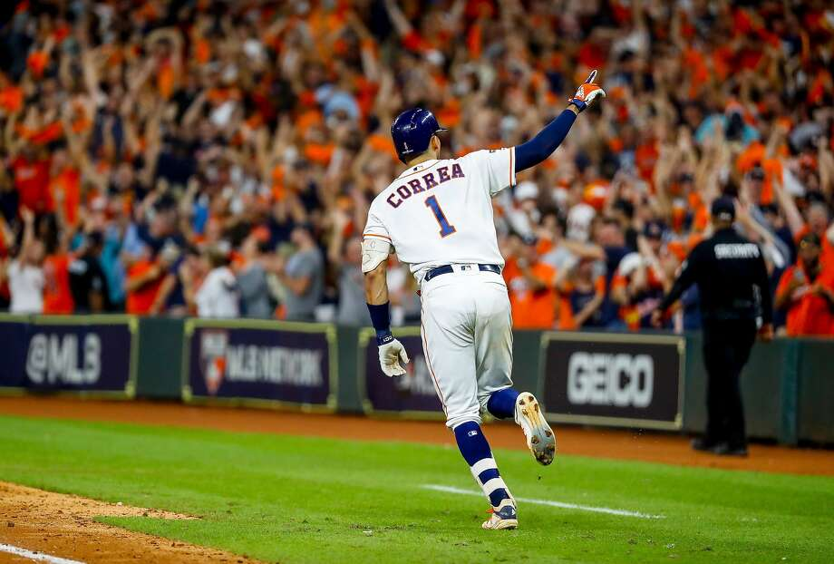 Houston's Carlos Correa celebrates during his trip around the bases after hitting a game-ending home run in the 11th inning. The blast tied the best-of-seven ALCS at 1-1. Game 3 is Tuesday in New York. Photo: Brett Coomer / Staff Photographer