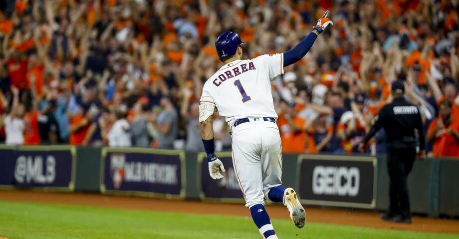 Houston Astros shortstop Carlos Correa (1) celebrates his walk off home run in the eleventh inning to win Game 2 of the American League Championship Series at Minute Maid Park on Sunday, Oct. 13, 2019, in Houston. Photo: Brett Coomer/Staff Photographer