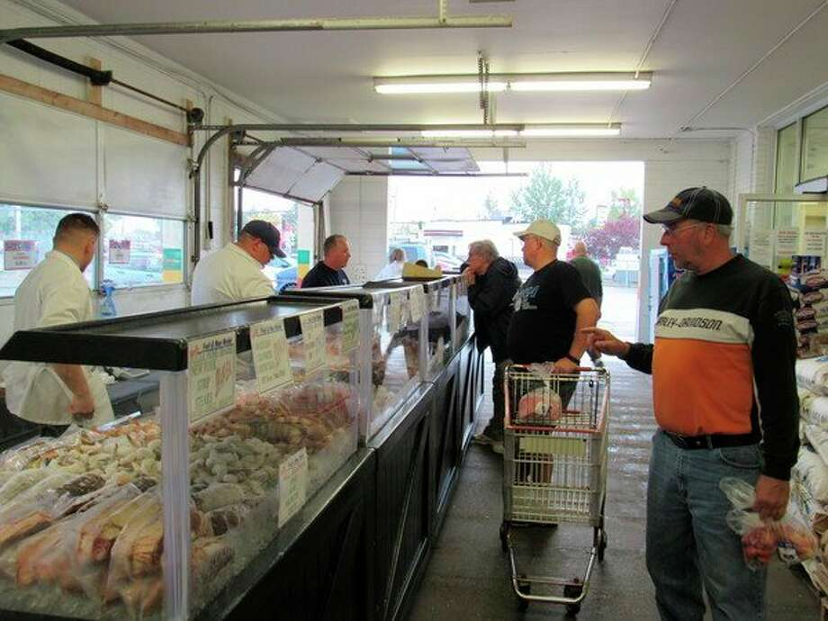 Patrons visit Jack's Fruit & Meat Market's Seafood Roadshow, Friday, Oct. 11. (Victoria Ritter/vritter@mdn.net)