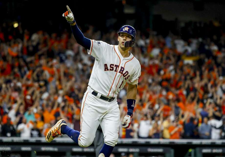 Houston Astros shortstop Carlos Correa (1) celebrates his walk off home run in the eleventh inning to win Game 2 of the American League Championship Series at Minute Maid Park on Sunday, Oct. 13, 2019, in Houston. Photo: Karen Warren/Staff Photographer