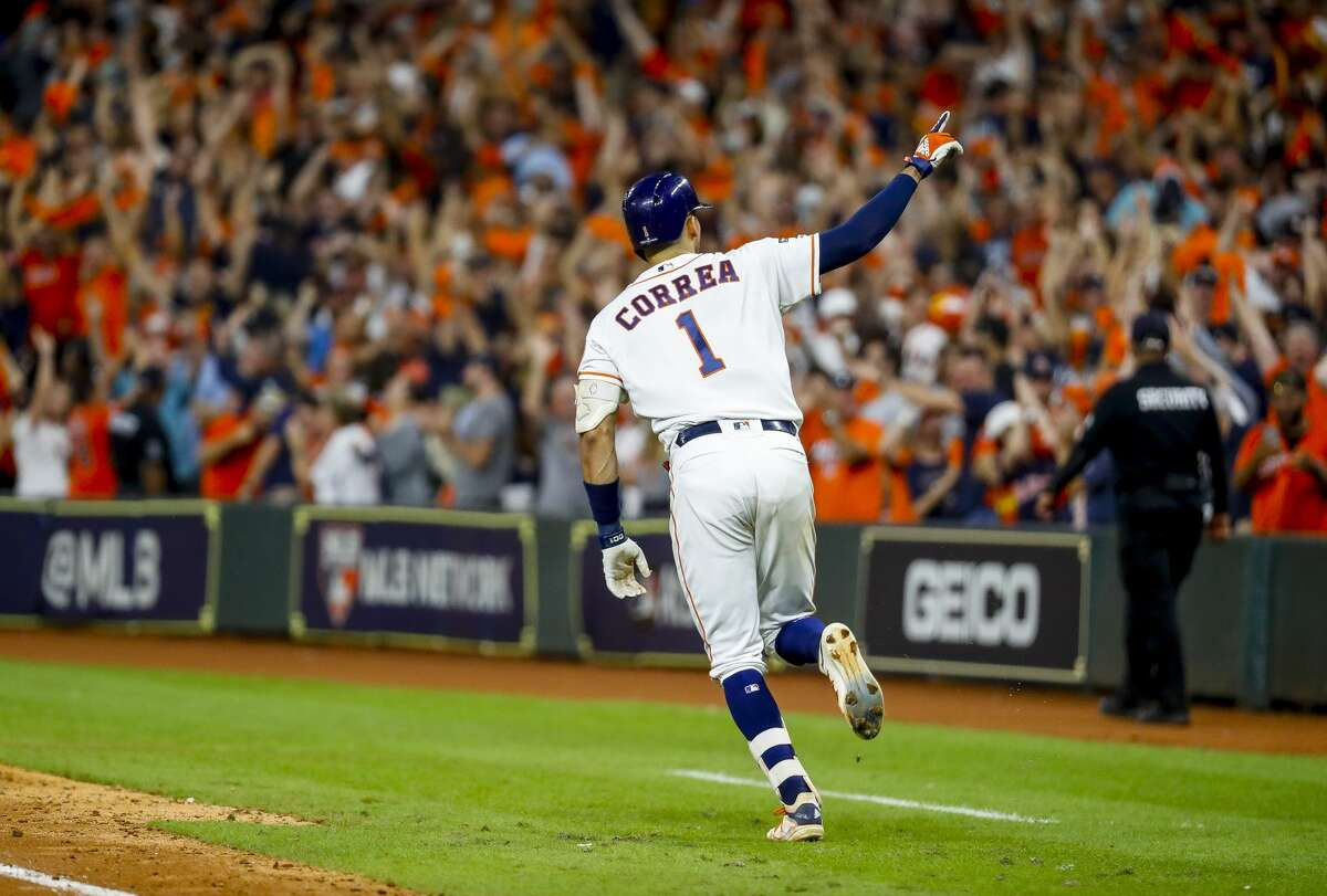 Houston Astros shortstop Carlos Correa (1) celebrates his walk off home run in the eleventh inning to win Game 2 of the American League Championship Series at Minute Maid Park on Sunday, Oct. 13, 2019, in Houston.
