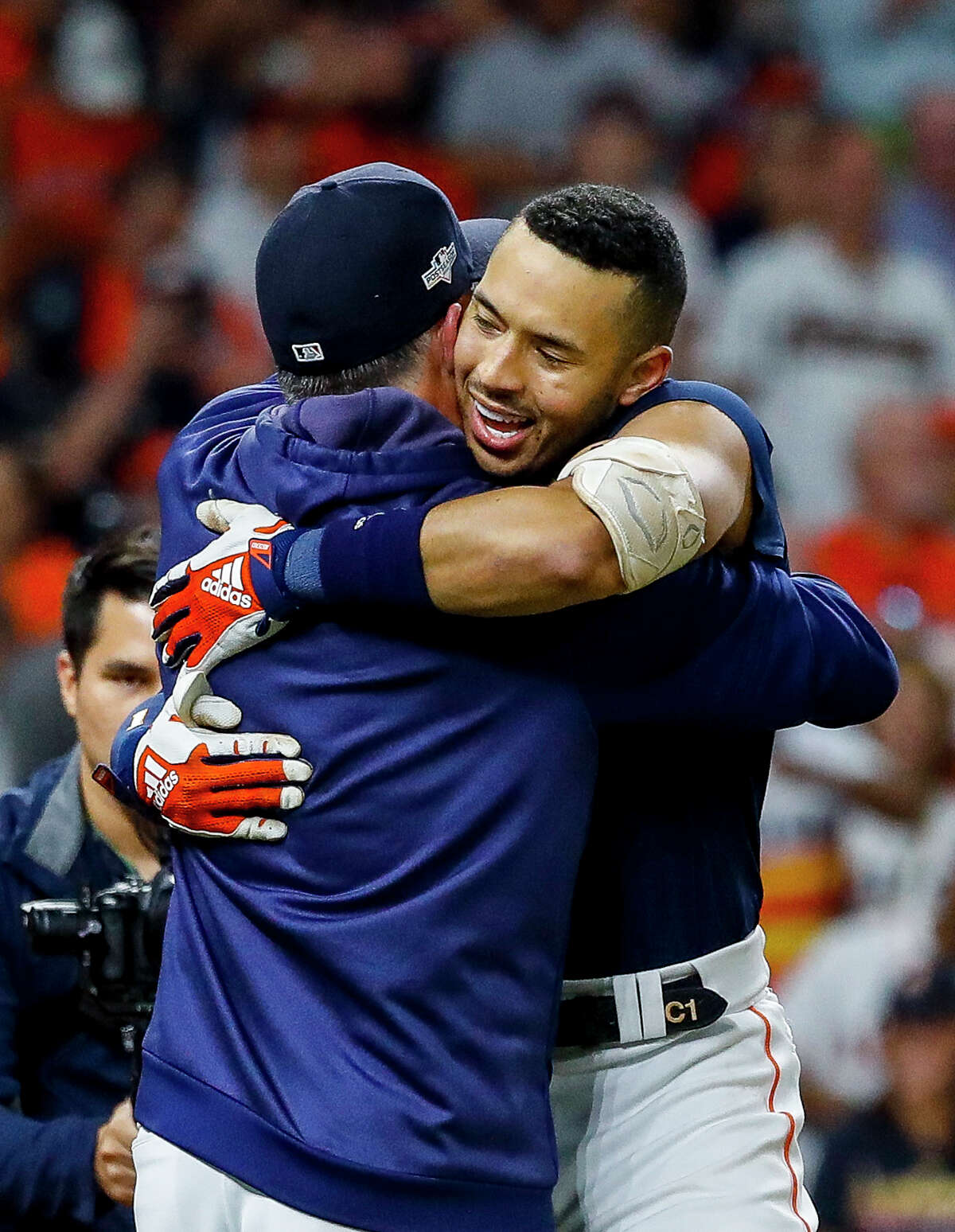 Houston Astros manager AJ Hinch (14) hugs Houston Astros shortstop Carlos Correa (1) after Correa hit a walk off home run in the eleventh inning to win Game 2 of the American League Championship Series at Minute Maid Park on Sunday, Oct. 13, 2019, in Houston.