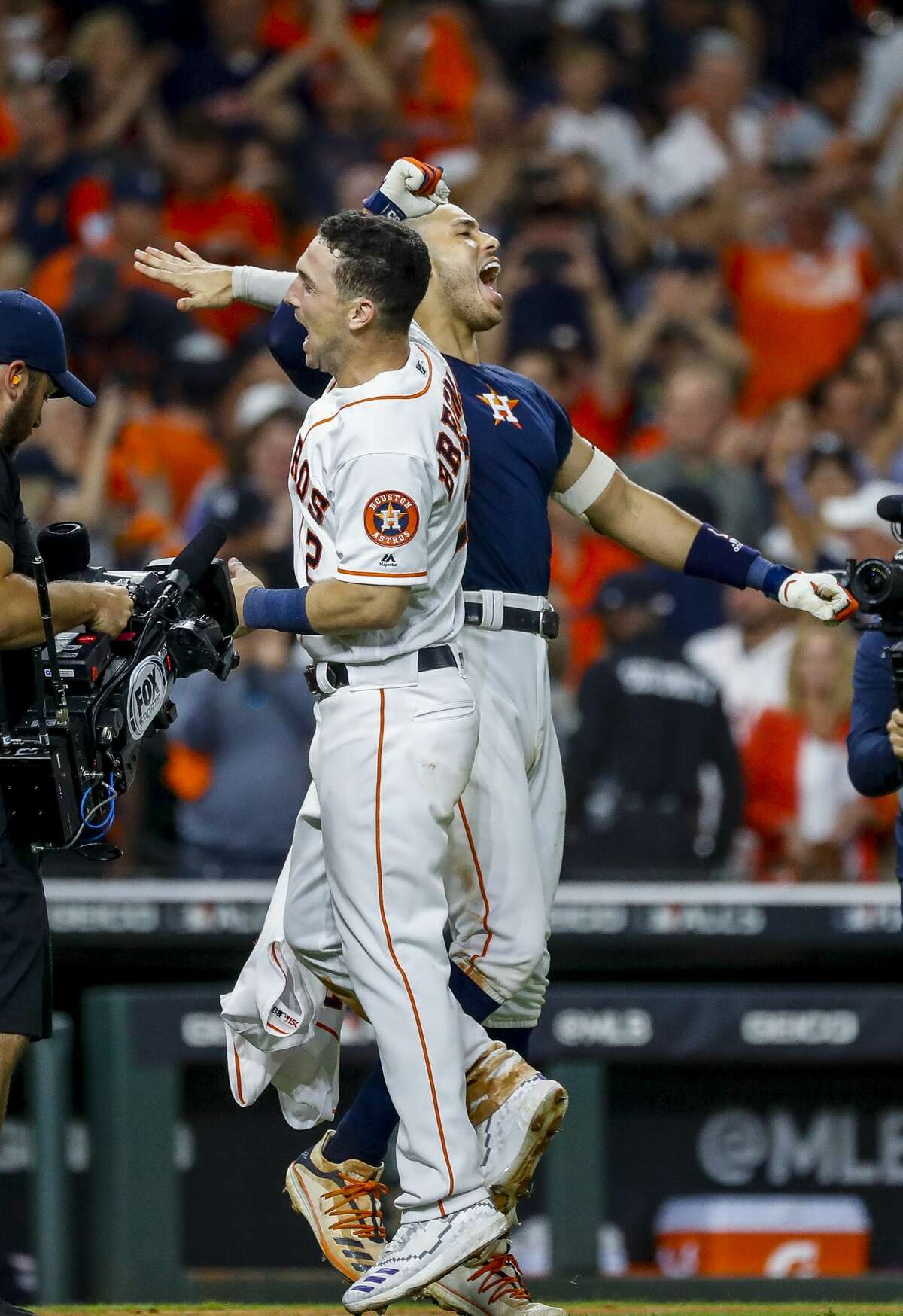Houston Astros third baseman Alex Bregman (2) and Houston Astros shortstop Carlos Correa (1) celebrate Correa's walk off home run in the eleventh inning to win Game 2 of the American League Championship Series at Minute Maid Park on Sunday, Oct. 13, 2019, in Houston.