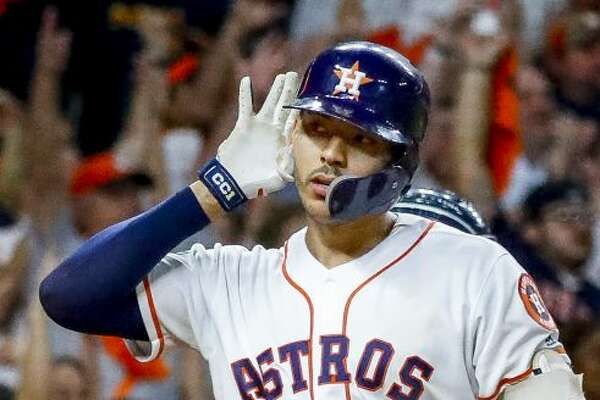Houston Astros shortstop Carlos Correa (1) stops to listen to the crowd as he hits a walk off home run in the eleventh inning to win Game 2 of the American League Championship Series at Minute Maid Park on Sunday, Oct. 13, 2019, in Houston.